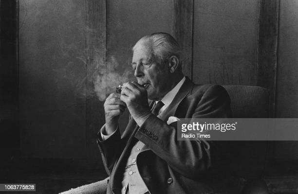 Portrait of former British Prime Minister Harold Macmillan lighting his pipe circa 1975