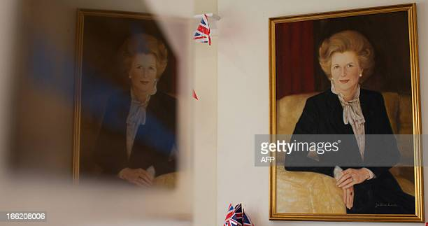 A portrait of former British prime minister Margaret Thatcher hangs on the wall at the Conservative Party headquarters in Finchley in north London on...