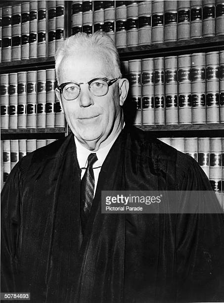 Portrait of former Chief Justice of the United States Supreme Court, Earl Warren wearing a glasses and smiling, circa 1960s.
