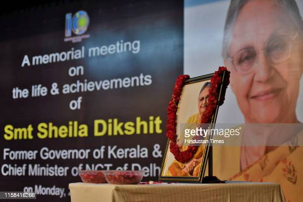 Portrait of former Chief minister of Delhi Sheila Dixit is seen garlanded during a memorial meeting on her life and achievements at India Islamic...