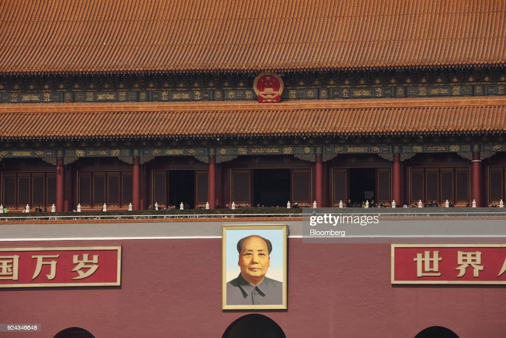 A portrait of former Chinese leader Mao Zedong hangs on display at Tiananmen Square in Beijing, China, on Monday, Feb. 26, 2018. China's Communist Party is set to repeal presidential term limits in a move that would allowXi Jinpingto rule beyond 2023, completing the country's departure from a political system based on collective leadership. Photographer: Giulia Marchi/Bloomberg via Getty Images