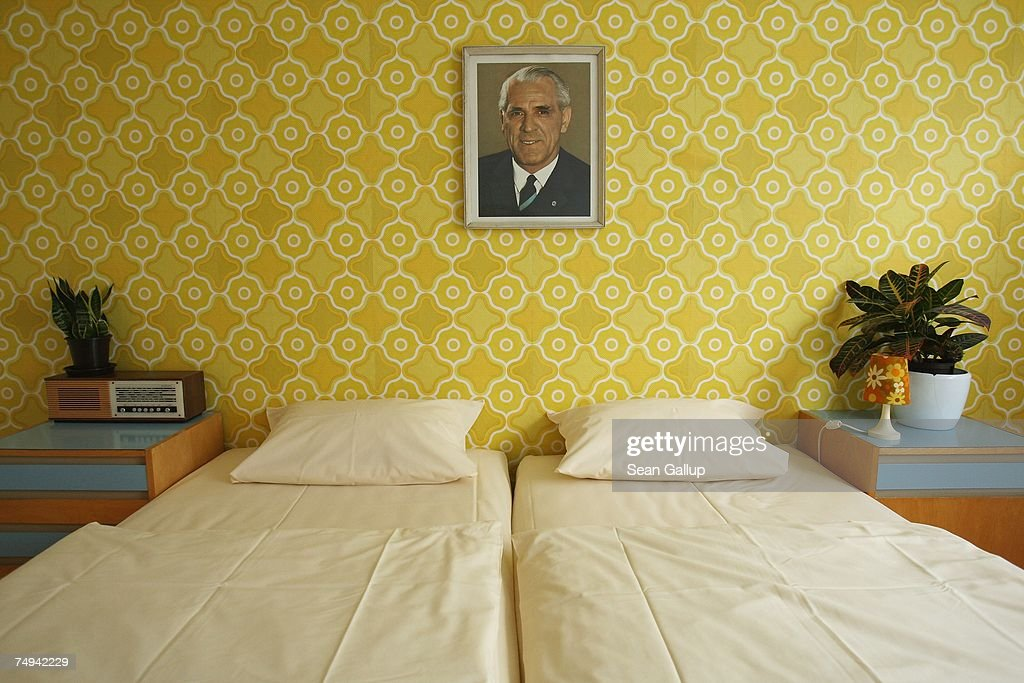 A portrait of former East German leader Willi Stoph hangs on the wall of a double room at the Ostel hotel in the East Berlin dsitrict of Friedrichshain June 28, 2007 in Berlin, Germany. The Ostel, which is a play on words in German for 'east' and 'hotel,' is furnished in the style of the former communist East Germany, or DDR. The hotel's owners have tapped into a growing nostalgia for and a certain chic of the DDR. Ostel, which opened its doors May 1, 2007, has been in instant hit with tourists.