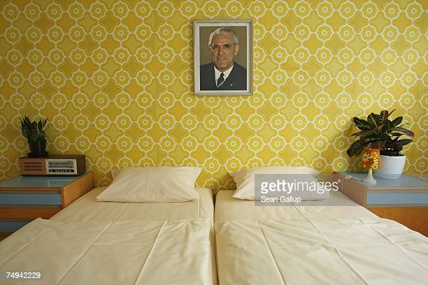 A portrait of former East German leader Willi Stoph hangs on the wall of a double room at the Ostel hotel in the East Berlin dsitrict of...