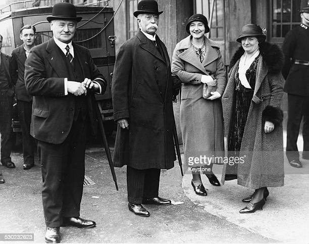 Portrait of former football player Sir Frederick Wall and Lady Wall with a group of ladies and gentlemen arriving at Wembley Stadium London February...