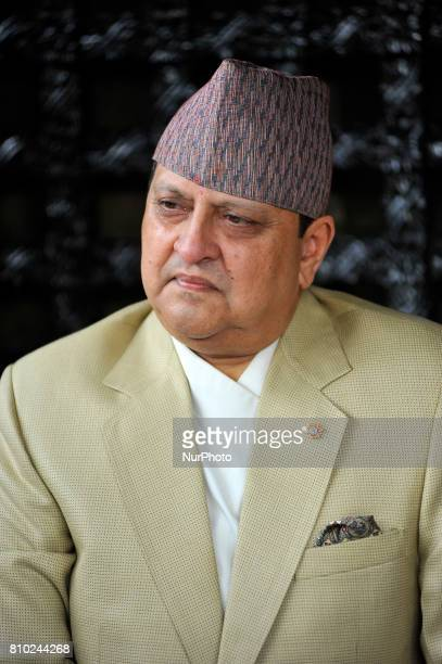 Portrait of Former King Gyanendra Shah arrives from his residence to receives a greeting from his supporters and well-wishers on his 71th birthday at...