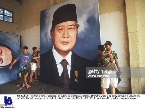 Portrait of former president of Indonesia Suharto are removed from the walls of an army barracks in Jakarta one day after Suharto resigned as...