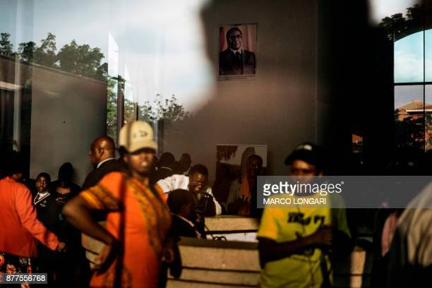 A portrait of former President Robert Mugabe hangs in the hall of the ZANUPF headquarter in Harare on November 22 2017 while supporters wait for the...