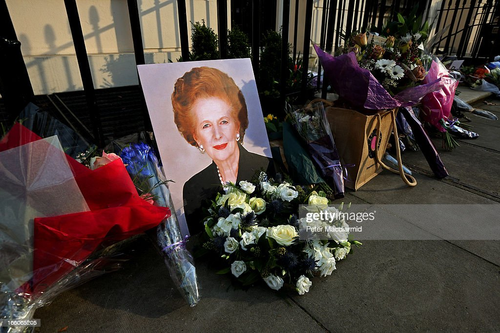 A portrait of former Prime Minister Margaret Thatcher is left next to floral tributes outside her residence in Chester Square on April 8, 2013 in London, England. Lord Bell, spokesperson for Baroness Margaret Thatcher, announced in a statement that the former British Prime Minister died peacefully following a stroke on 8th April, aged 87.