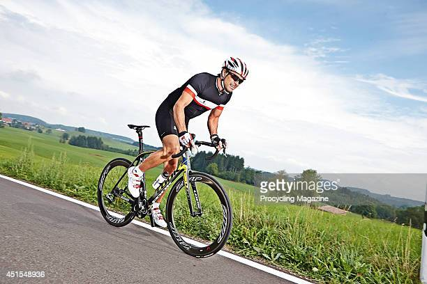 Portrait of former pro cyclist Marcel Wust test riding a Look 695 Aerolight bicycle on a rural road, taken on October 8, 2013.