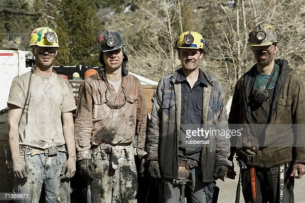 Portrait of four coal miners
