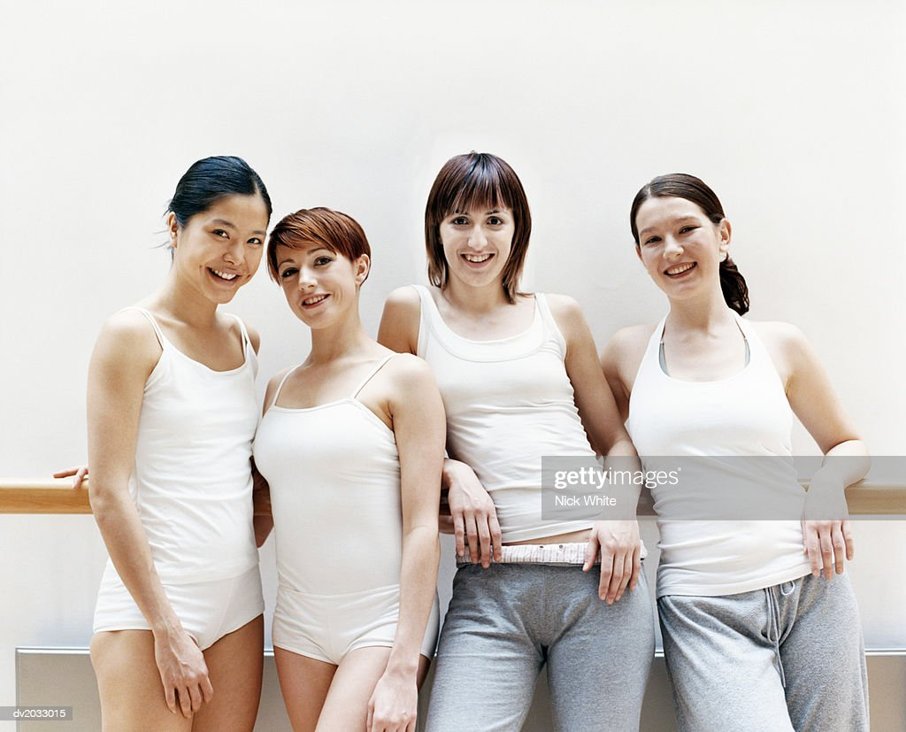 Portrait of Four Female Dancers Standing in a Line : Stock Photo