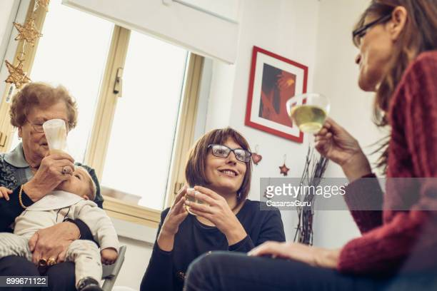 portrait of four generation women together at christmas - great granddaughter stock photos and pictures