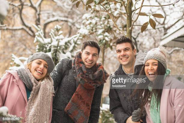 Portrait of four happy young people