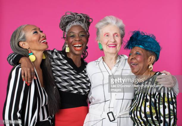 portrait of four older confident women laughing - noapologiescollection stock pictures, royalty-free photos & images
