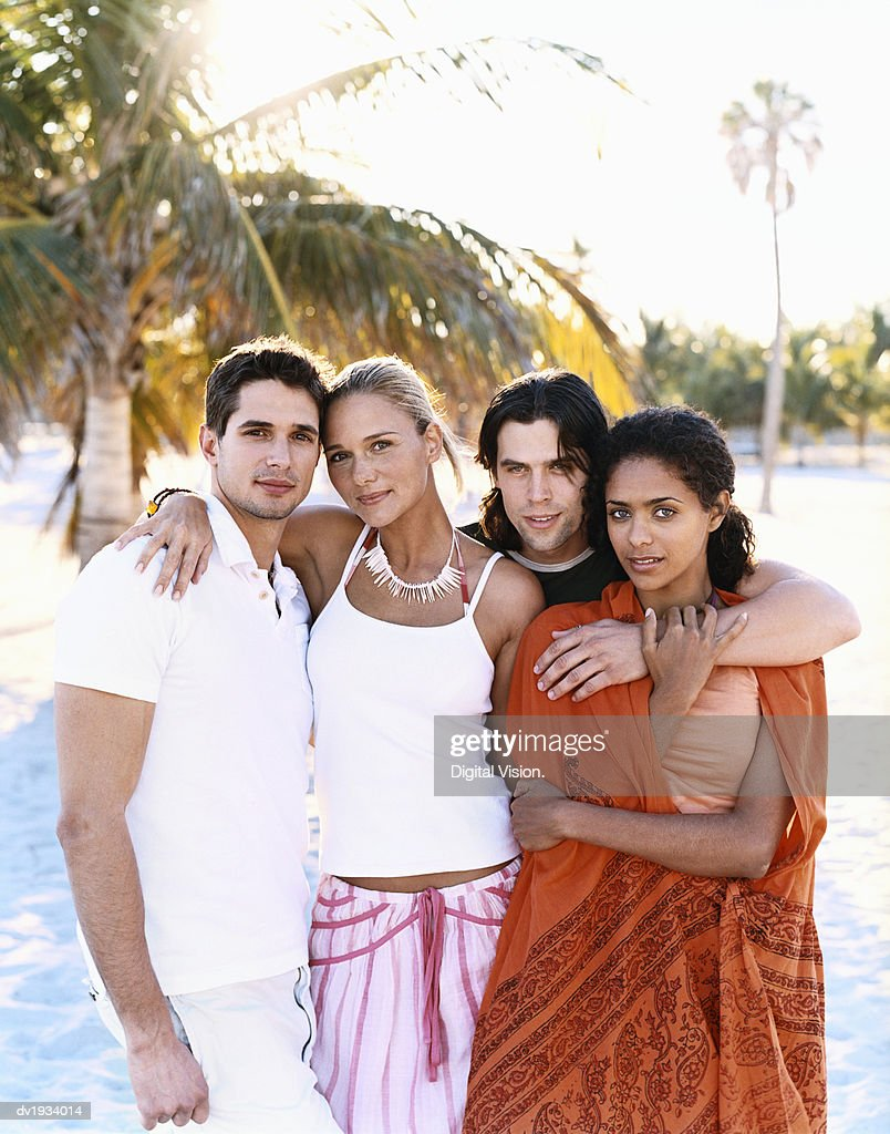 Portrait of Four People on the Beach : Stock Photo