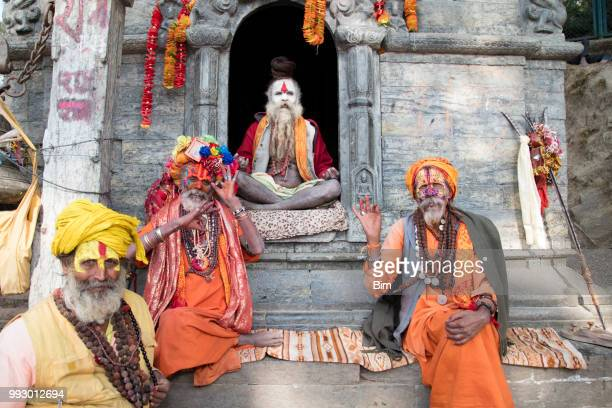 portrait of four sadhu, holy men, kathmandu, nepal - kathmandu stock pictures, royalty-free photos & images