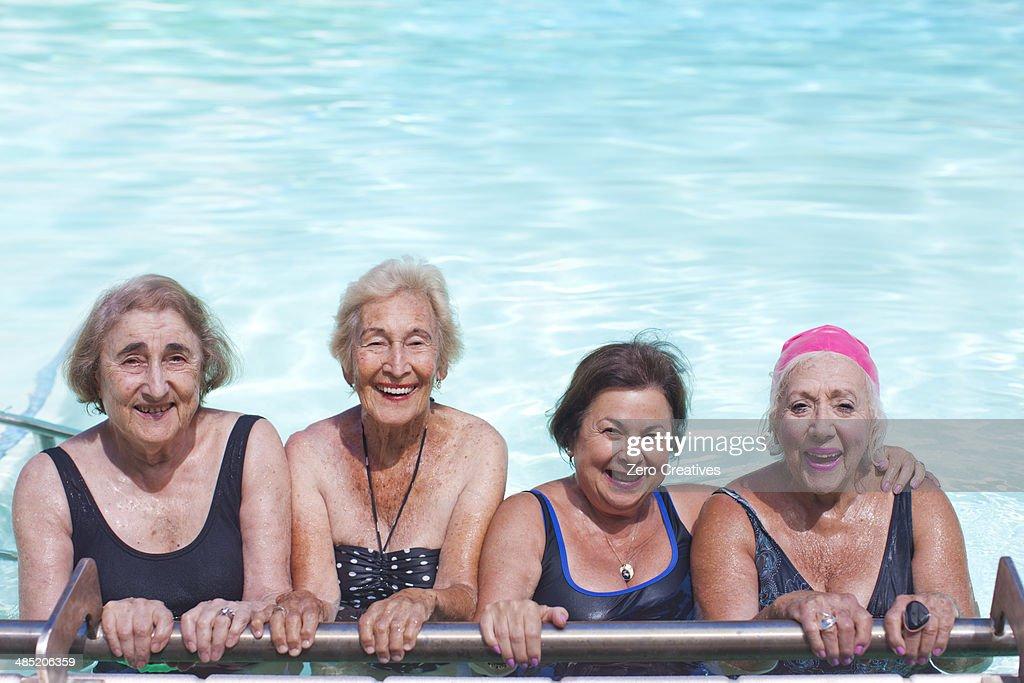 Portrait of four senior women in swimming pool : Stock Photo