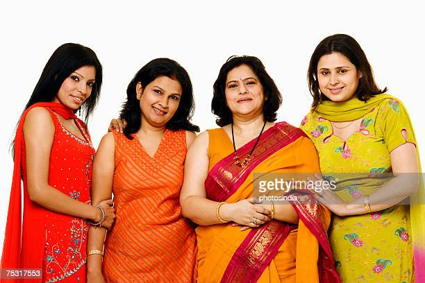 Portrait of four women smiling together