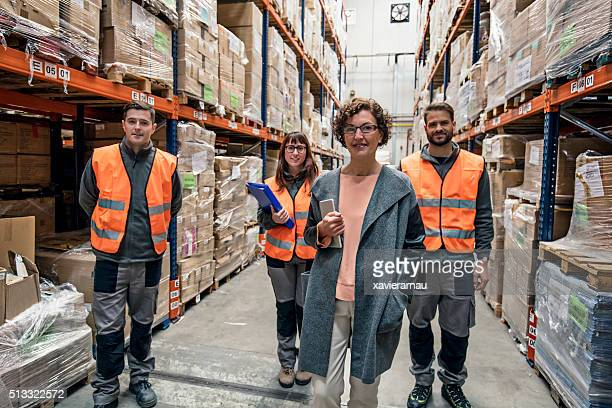 Portrait of four workers in a distribution warehouse