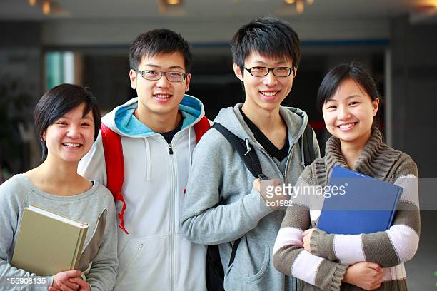 portrait of four young college students