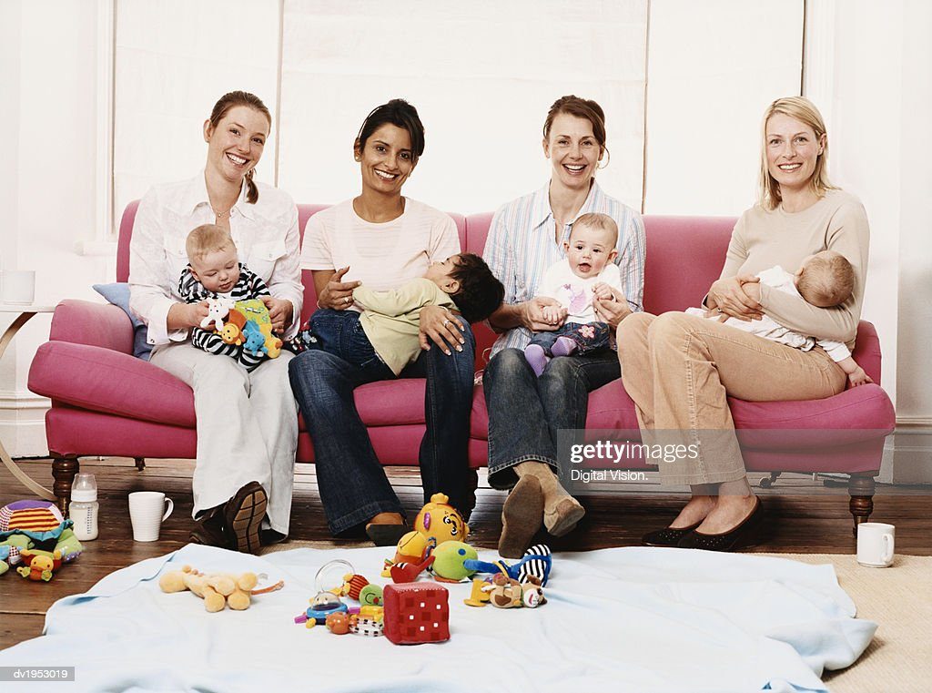 Portrait of Four Young Mothers with Their Children : Stock Photo