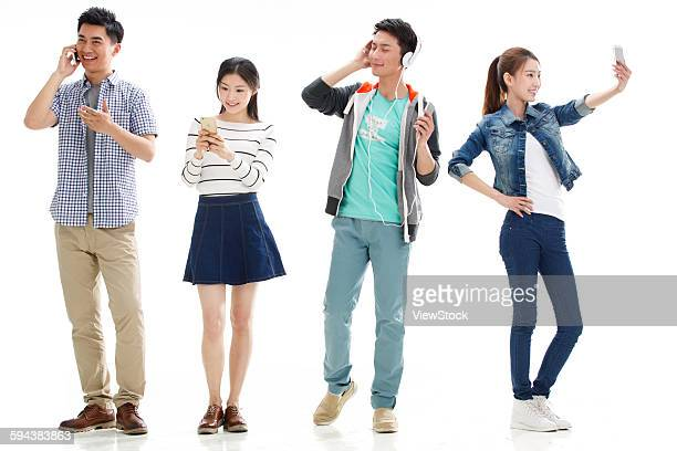 Portrait of four young people with cell phone
