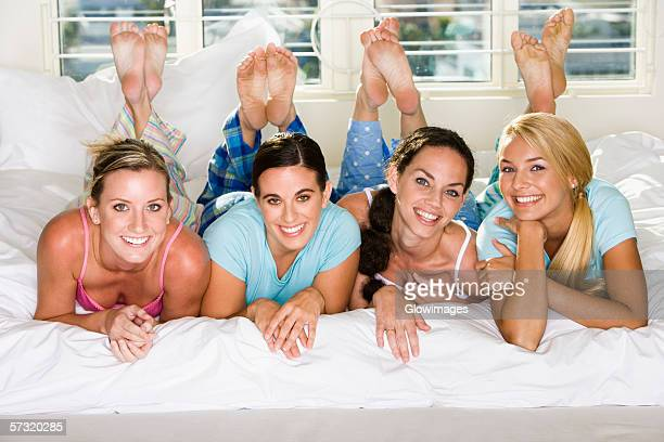 portrait of four young women smiling - soles pose stock photos and pictures