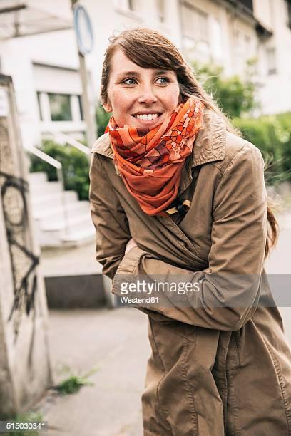 Portrait of freezing woman wearing orange scarf