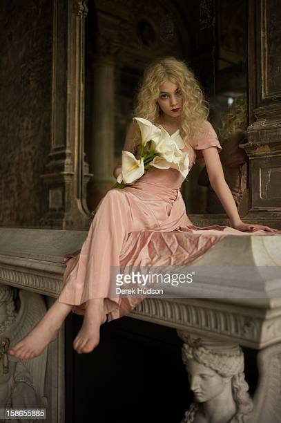 Portrait of French actress Anamaria Vartolomei sits atop a fireplace mantel during a photo shoot Paris France April 13 2011 The shoot was in...