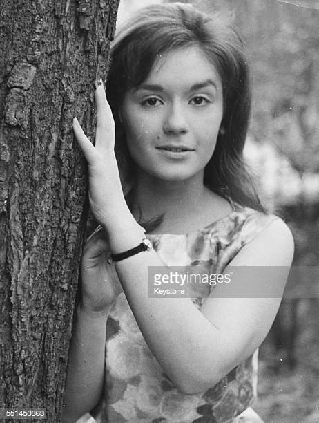 Portrait of French actress Daniele Evenou star of 'Un Chien Dans Un Quilles' leaning against a tree April 4th 1962
