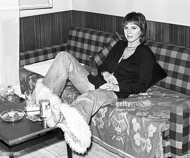 Portrait of French actress Haydee Politoff as she sits on a couch Madrid Spain 1972