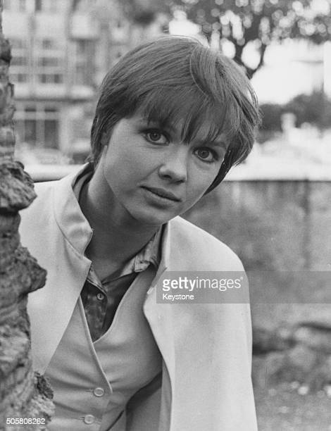 Portrait of French actress Haydee Politoff wearing a cape on the outdoor set of the film 'The Years of Youth' circa 1969