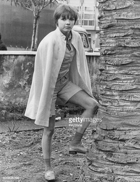 Portrait of French actress Haydee Politoff wearing shorts and a cape on the outdoor set of the film 'The Years of Youth' circa 1969