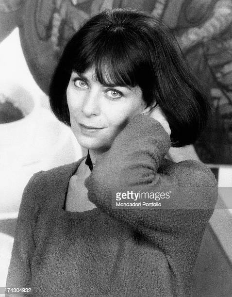 Portrait of French actress Juliette Mayniel with a hand in her hair Rome 1970s