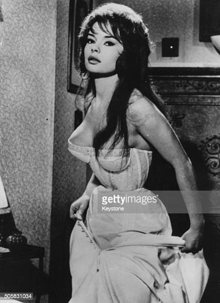 Portrait of French actress Pascale Petit wearing a corset circa 1960
