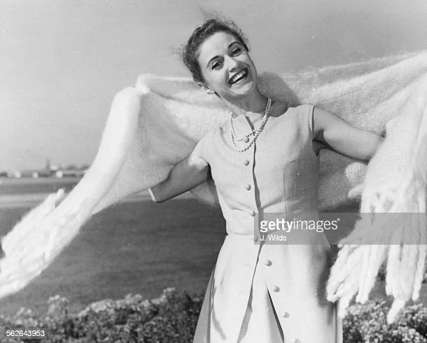 Portrait of French dancer Violette Verdy smiling as she lands in the country to appear in the musical 'The Princess' at the Strand Theatre, at London...