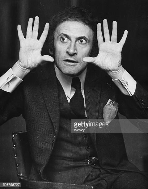 Portrait of French mime artist Marcel Marceau gesticulating with his hands, at a press conference, Saville Theatre, London, October 30th 1967.