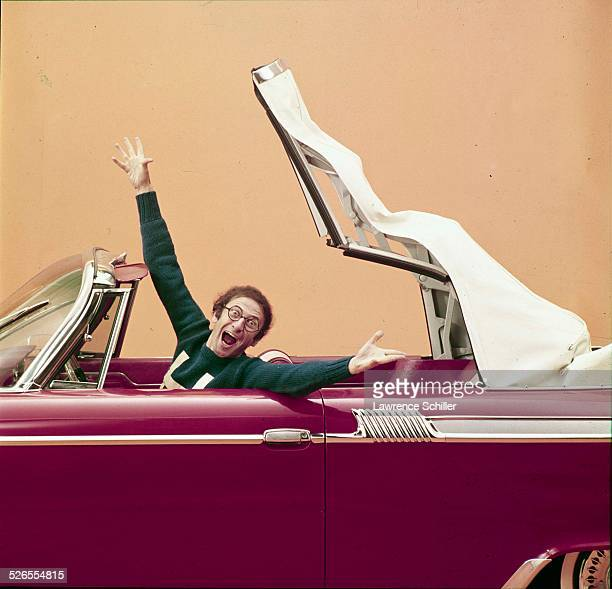 Portrait of French mime Marcel Marceau as he poses in a convertible, New York, New York, 1961. This image was taken from a photoshoot for Show...