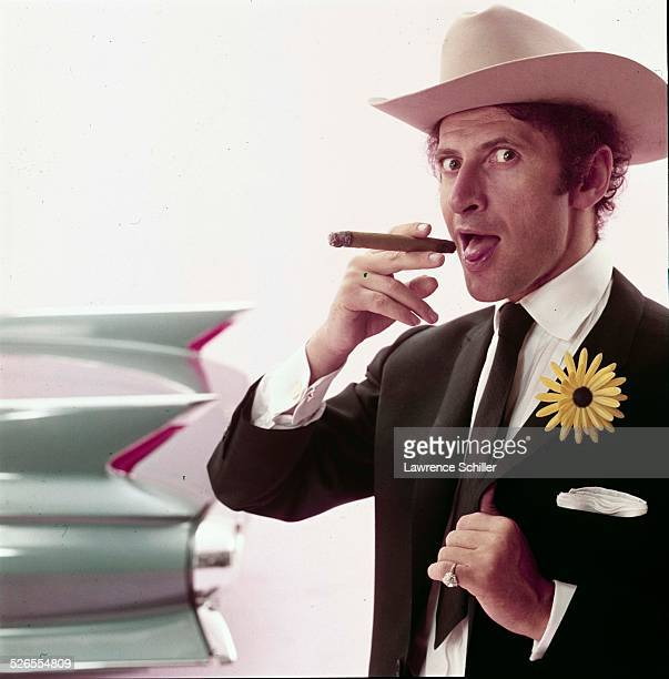 Portrait of French mime Marcel Marceau as he poses in a Stetson hat and a with a cigar, New York, New York, 1961. This image was taken from a...