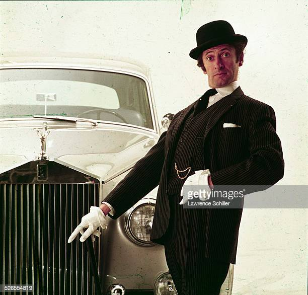Portrait of French mime Marcel Marceau as he poses in front of a Rolls Royce, New York, New York, 1961. This image was taken from a photoshoot for...