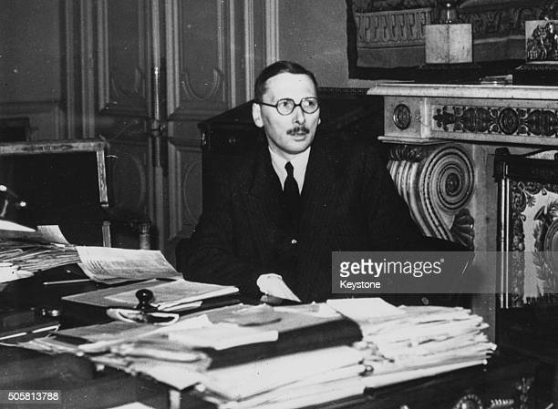 Portrait of French Minister of Finance Rene Pleven working at his desk, circa 1941.