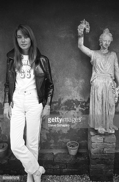 Portrait of French pop musician and actress Francoise Hardy as she poses beside a statue Venice Italy September 1966
