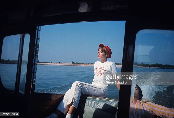 Portrait of French pop musician and actress Francoise Hardy as she sunbathes on a boat, Venice, Italy, September 1966.