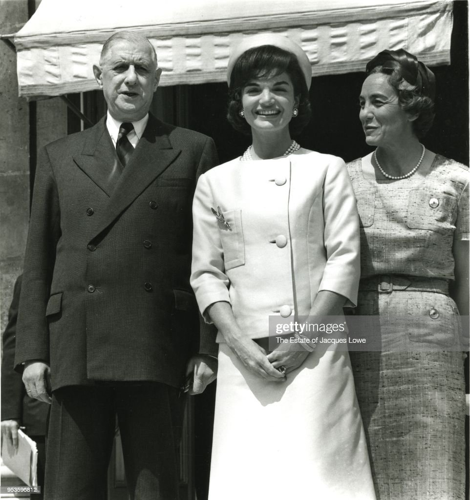 Portrait of French President Charles de Gaulle (1890 - 1970) and his wife, Yvonne de Gaulle (nee Vendroux, 1900 - 1979) (right), on either side of US First Lady Jacqueline Kennedy (nee Bouvier, 1929 - 1994) on the steps of Elysee Palace, Paris, France, between March 31 and June 2, 1961.