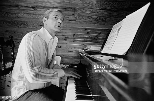 Portrait of French singer William Sheller playing the piano in 1976