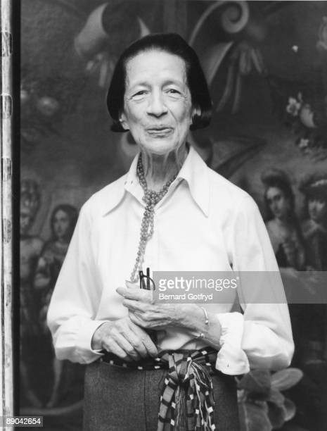 Portrait of Frenchborn American fashion editor Diana Vreeland as she stands with a pair of glasses in her hand late 1970s or early 1980s