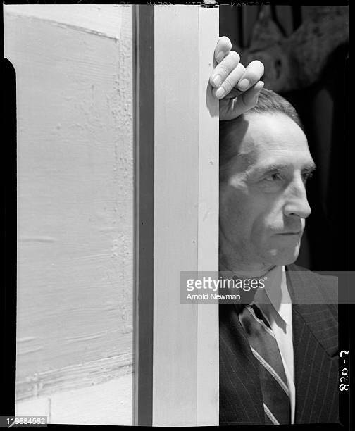 Portrait of French-born artist Marcel Duchamp as he leans against a door to his 'First Papers of Surrealism' exhibition at the Whitelaw Reid mansion,...