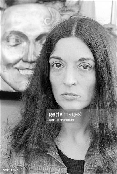 Portrait of French-born artist Marisol Escobar with her sculpture at a park, New Jersey, May 12, 1974.
