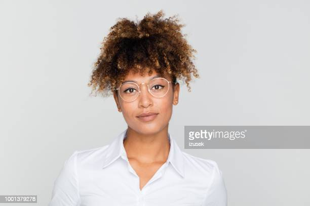 portrait of friendly afro amercian businesswoman - mixed race person stock pictures, royalty-free photos & images