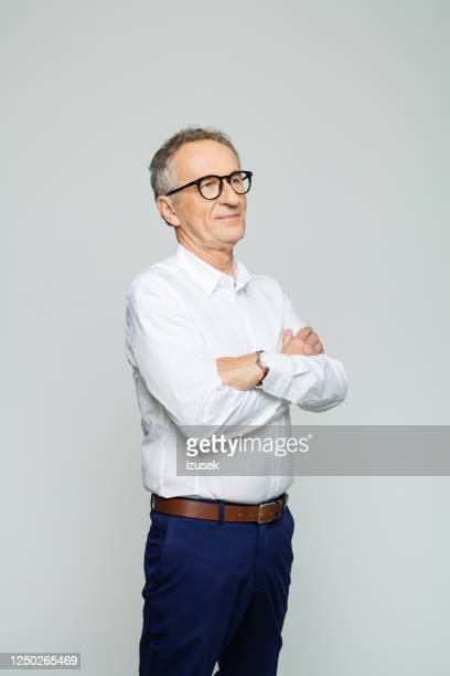 portrait of friendly senior businessman - white shirt stock pictures, royalty-free photos & images